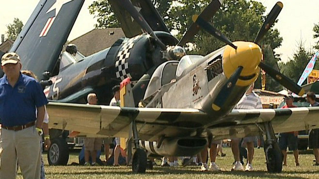Checking out vintage airplanes at the Wings-N-Wheels event in Howland on Sunday, Aug. 9, 2015_48361