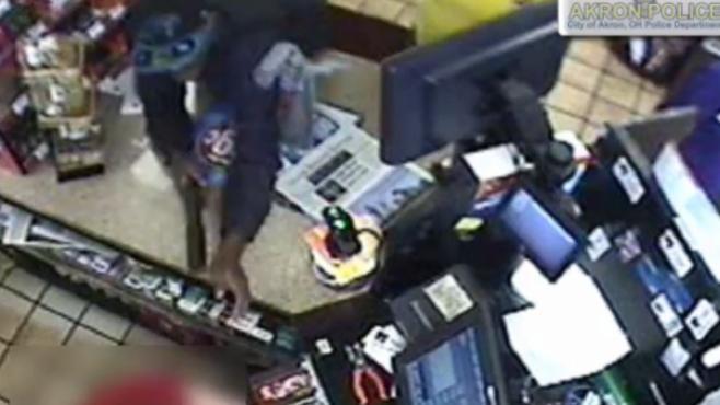 Man robs Akron Circle K at gunpoint, video captures crime_55602