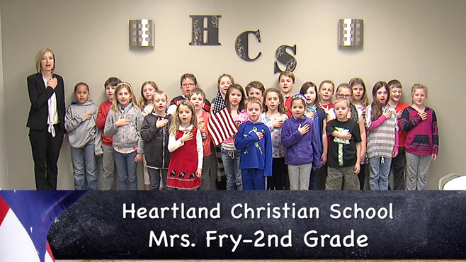 Mrs. Fry's Heartland Christian School second grade class reciting the Pledge of Allegiance_60469