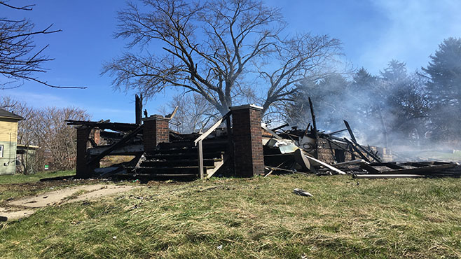 Vacant home collapses after early morning fire_72200