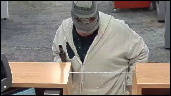 Two suspects robbed a PNC Bank in Youngstown at gunpoint.