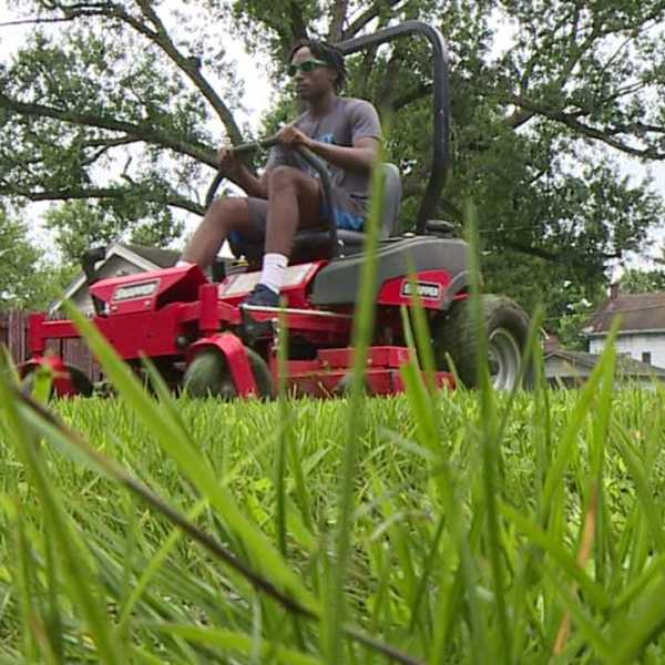 Grass cutting program through the Mahoning County Land Bank for Youngstown teens-873777806