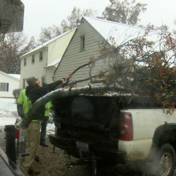 cleaning up after storm in Salem-873777806