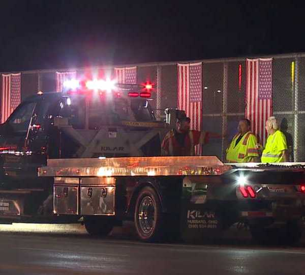 Just before dark, tow truck drivers and other emergency responders around Youngstown lined up along the overpass of Route 46 and Interstate-80 in Austintown.