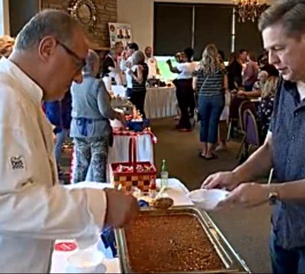 First News reporter Gerry Ricciutti serves up his homemade chili at Annual Chili Cookoff. He wins Favorite Celebrity.